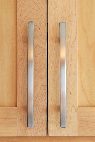 brushed silver door handles on maple cabinet doors kitchen
