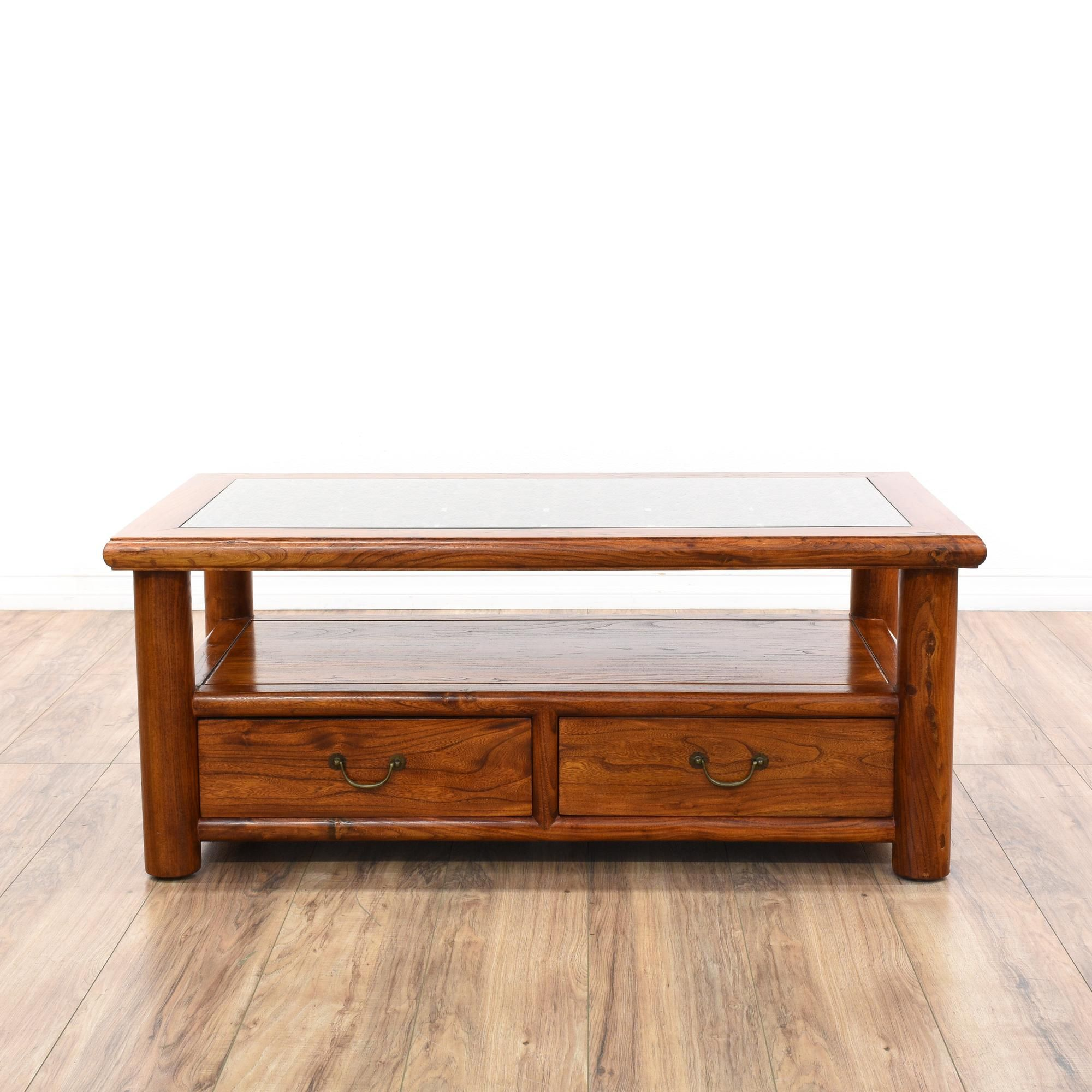 This asian coffee table is featured in a solid wood with a