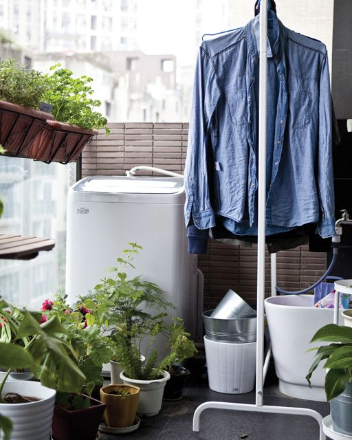 If you have a covered balcony, save space indoors and dry your clothes on a drying rack that can easily taken back inside