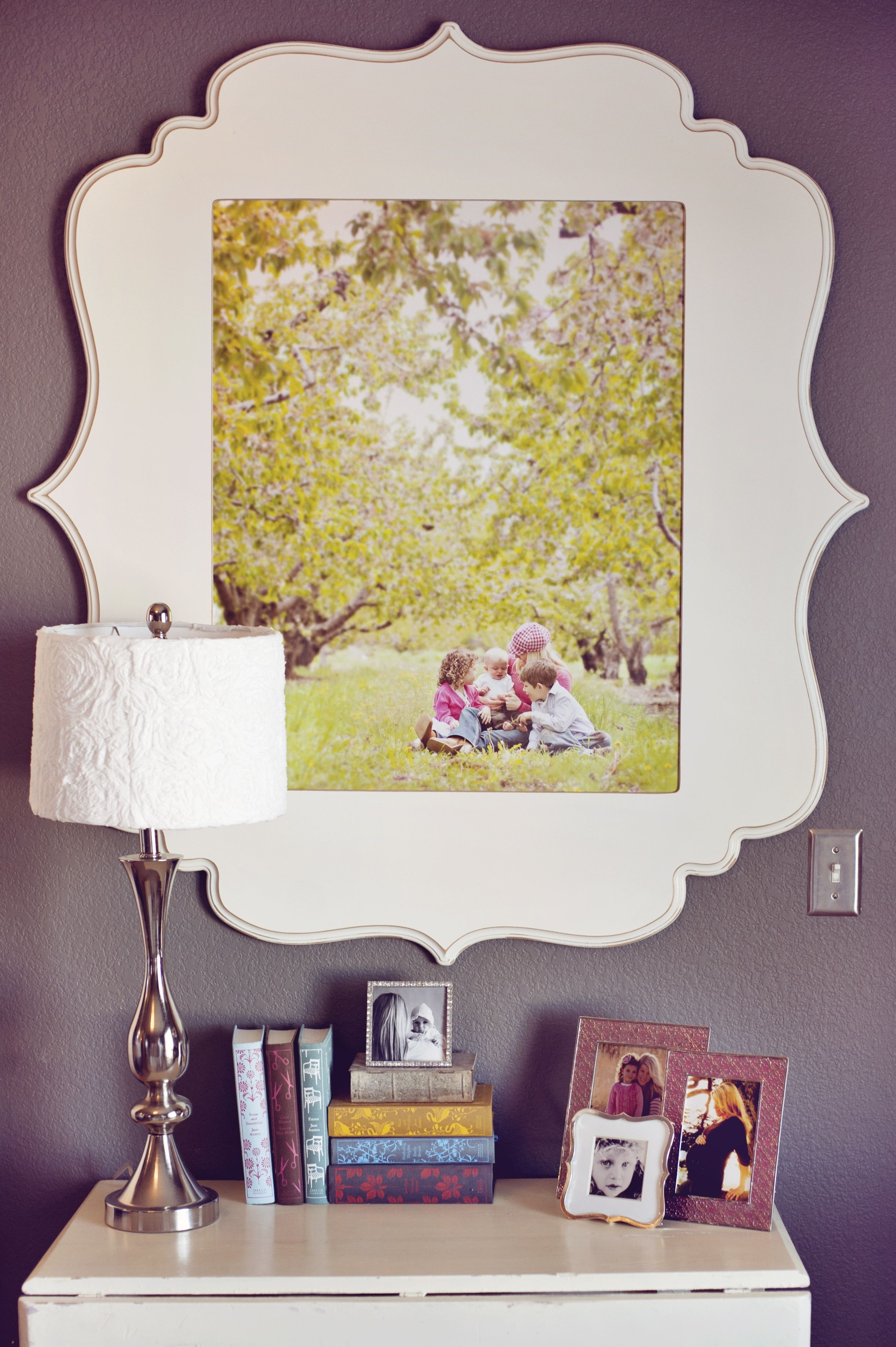 A stunning dining room wall display witih black and white photos and ...