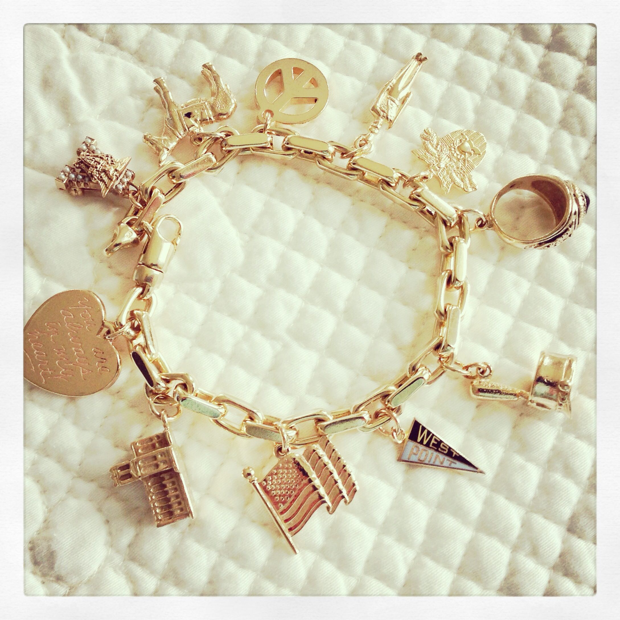 USMA charm bracelet. Gold West Point charms.