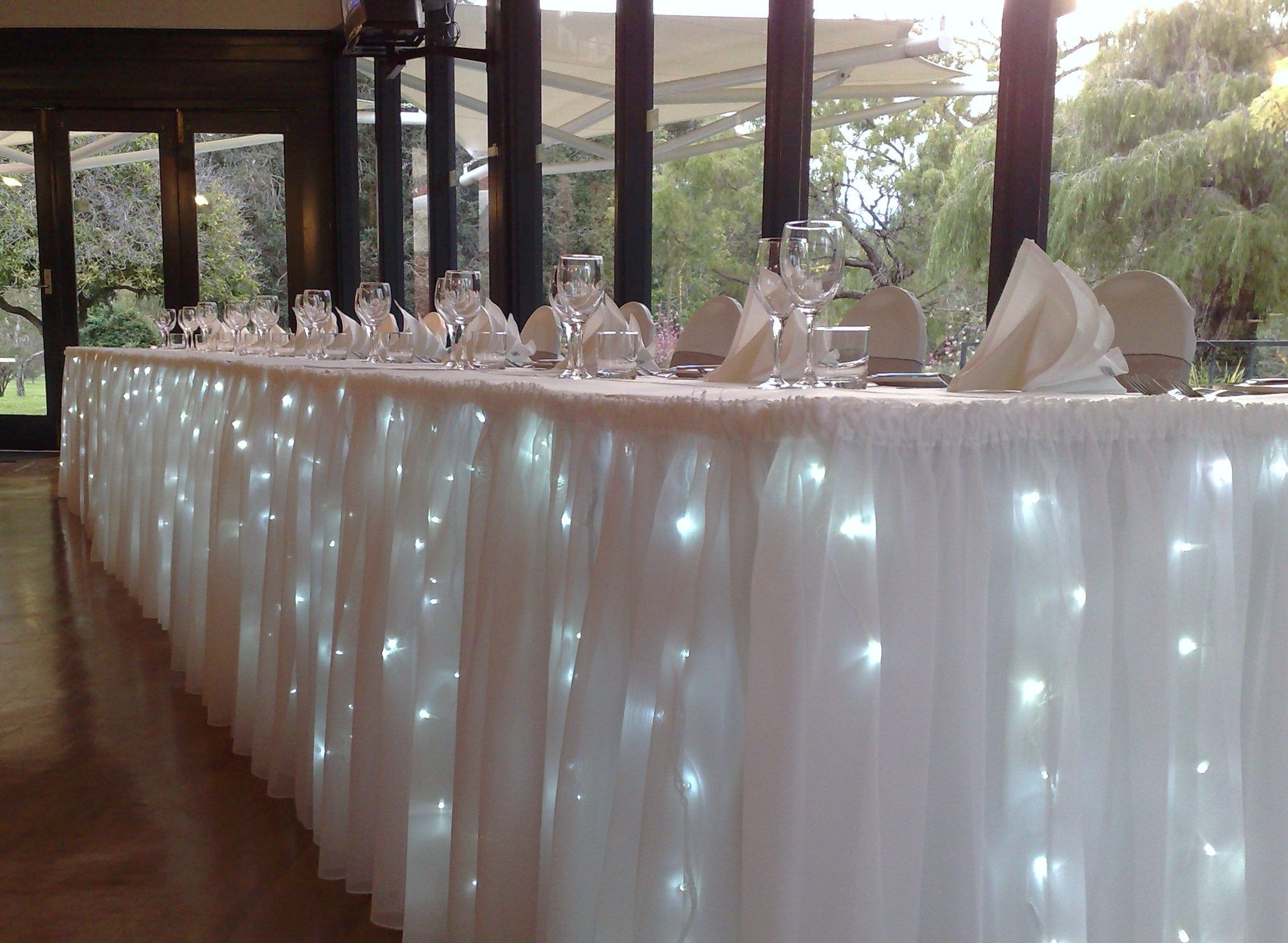 Elegant wedding decoration ideas  Lights under the tableshead table and cake table  wedding