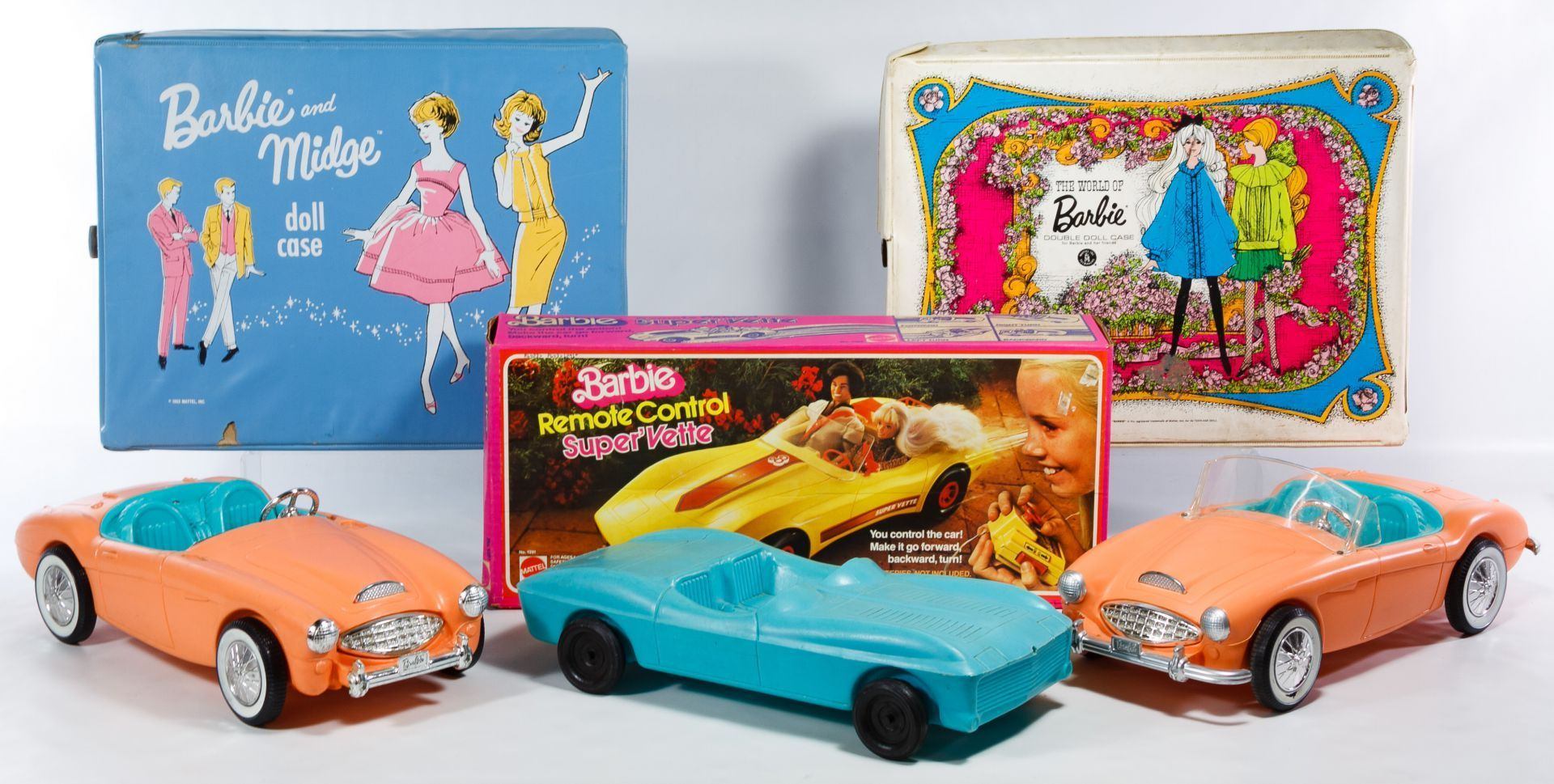 Lot 608: Mattel Barbie Car and Wardrobe Case Assortment; Including a 1963 Barbie and Midge case, a 1968 World of Barbie case, a 1979 Barbie Remote Control Super'Vette car in original box, two Barbie cars and an Irwin vinyl car #barbiecars Lot 608: Mattel Barbie Car and Wardrobe Case Assortment; Including a 1963 Barbie and Midge case, a 1968 World of Barbie case, a 1979 Barbie Remote Control Super'Vette car in original box, two Barbie cars and an Irwin vinyl car #barbiecars