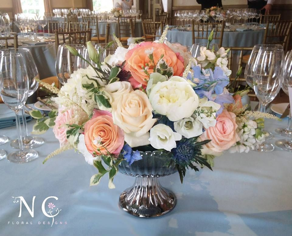 Silver bowl centerpiece including coral pale pink cream
