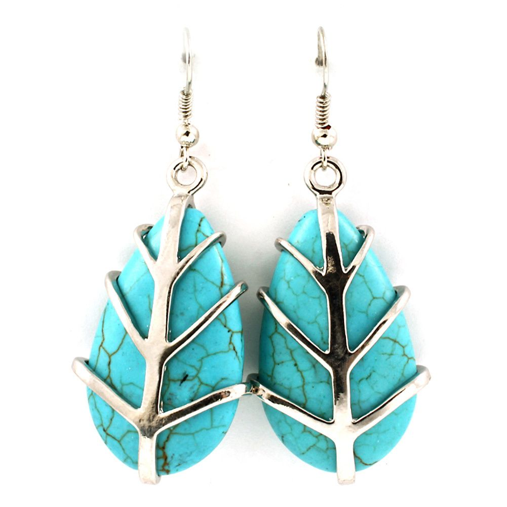Joji Boutique - turquoise teardrop earrings with silver tree overlay, (http://www.jojiboutique.com/products/turquoise-teardrop-earrings-with-silver-tree-overlay.html)