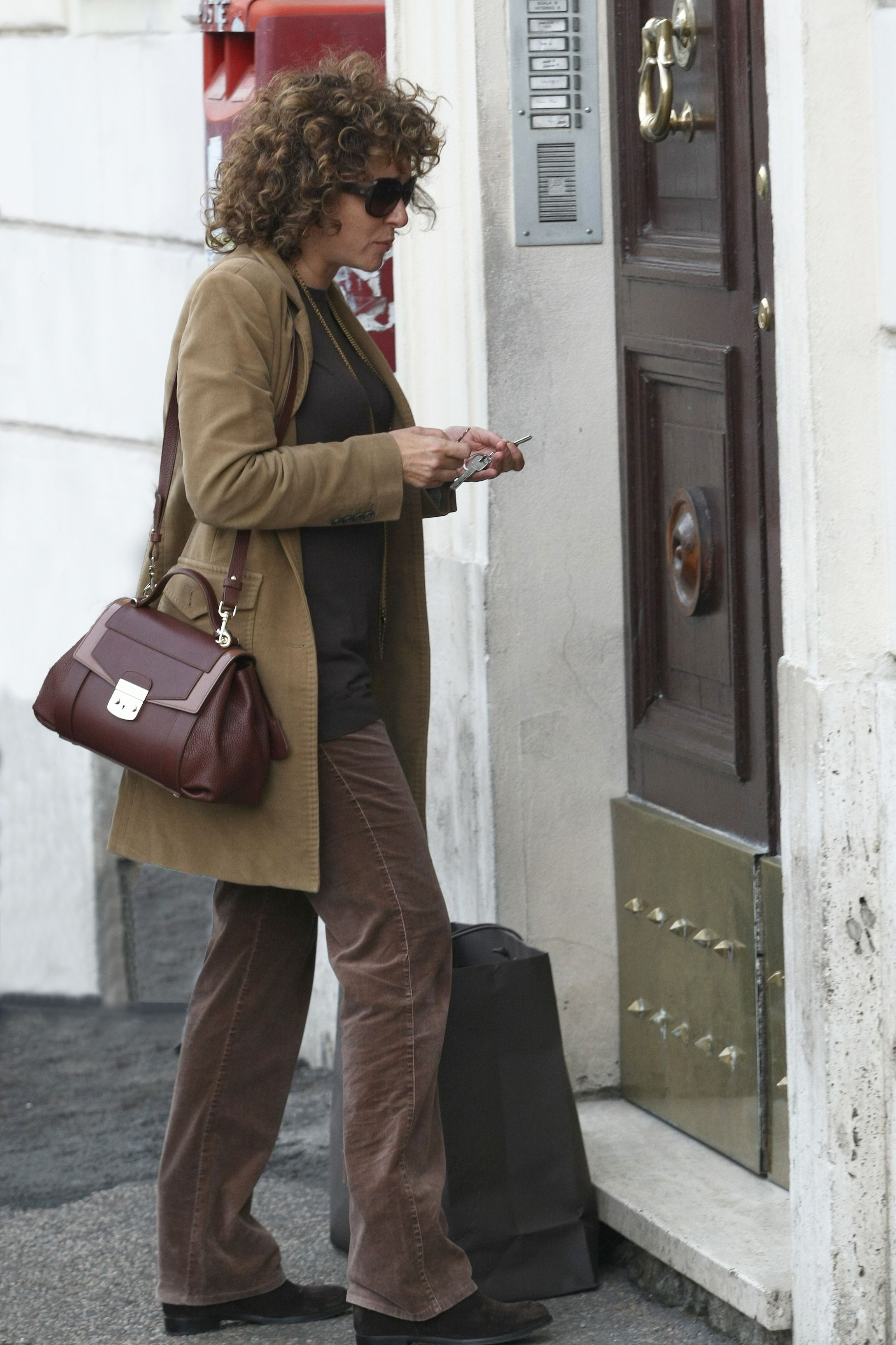 Valeria golino celebrities in trussardi pinterest boutique delivery and celebrity Celebrity style fashion boutique