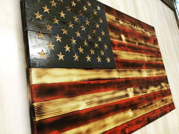 BEST SELLER! This flag has been built with American spruce and stained with Old Glory's traditional colors. Each star is hand carved, and it is charred prior to assembly for a timeless finish. Proudly display your love for our country in your home or business with the Charred American Traditional flag.