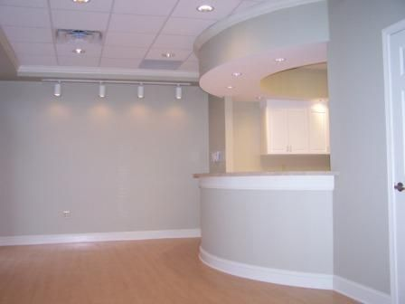 Office reception area. i would paint the walls another color but