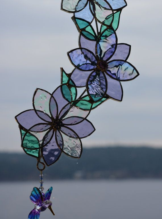 Stained Gl Flowers With Hummingbird This Suncatcher Features Three Blue And Mauve A Beautiful Purple