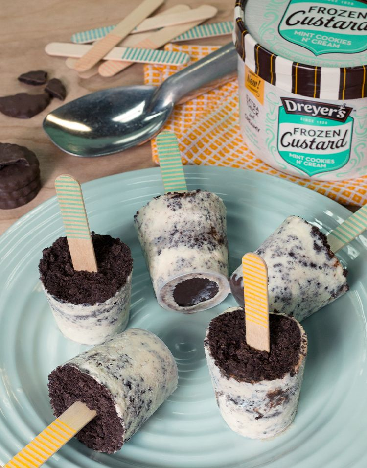 Dreyer's Frozen Custard Cookie Pop: The whole family will be thrilled when they get their hands on these delicious treats! Step 1: Scoop a layer of Mint Cookie 'N Cream Frozen Custard into the bottom of a paper cup. Step 2: Sprinkle a layer of chocolate cookie crumble. Step 3: Repeat until the cup is filled. Step 4: Freeze. Step 5: Pop one out and enjoy!