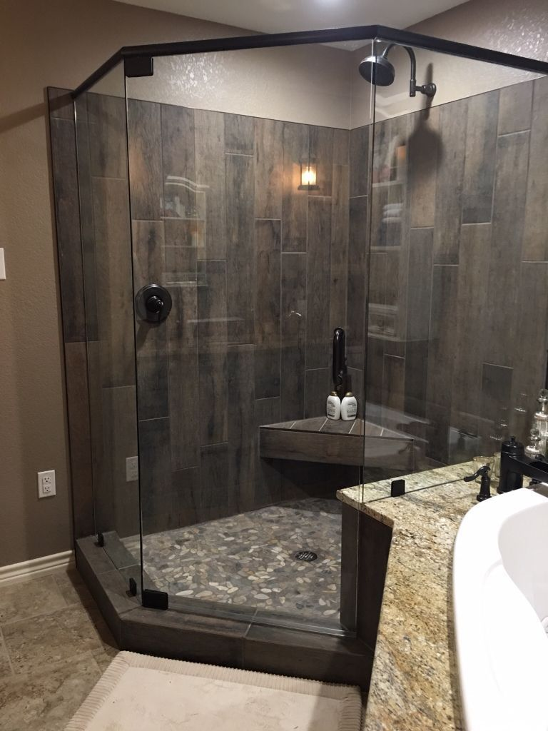 Photo of Guest shower with barn-style tiles made of gray weathered wood and …