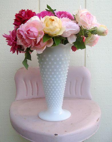 English roses in milk glass vase