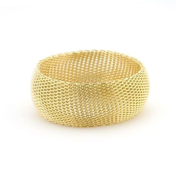 Bracelets 14k Gold Bonded Wide Mesh Bracelet in Goldtone. Monaco Gold Bangle features 14k gold bonded to a fashion metal. This piece is pure fun and easy on the shopping budget! 14k Bonded Gold is achieved using an electroplating process that coats the item with heavy layers of 18k Yellow Gold and color-treated to a perfect 14k Hamilton gold color. Base Metal: Lead Free Alloy Clasp: Size: Item Weight: 64g Carat Weight: Backing: Chain: Length: 66mm Width: 28mm Height: 5mm oxemegifts.com