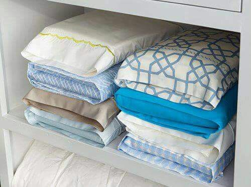To save space fold your flat sheet, fitted sheet, and remaining pillow case and store them in the pillow case.
