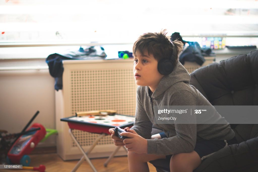 10 Years Old Boy Playing Consol Game At Home Boys Playing Play Game Online Kids Playing