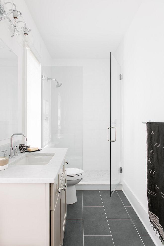 crisp white bathroom with black slate floor tile bathroom