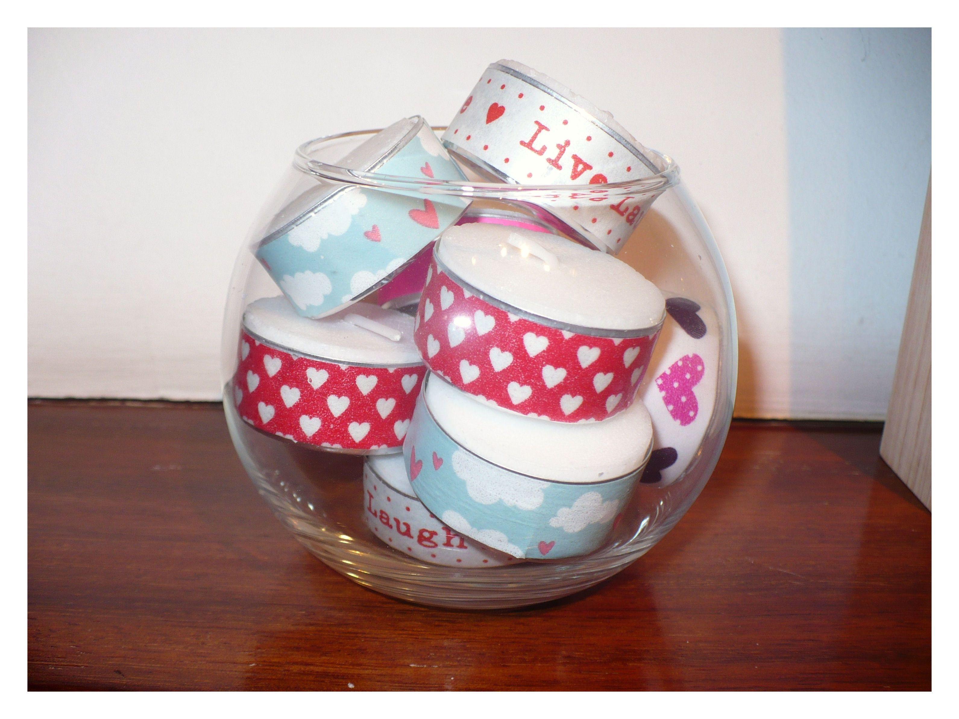 Velas decoradas con washitape de motivos romanticos en una - Peceras pequenas decoradas ...