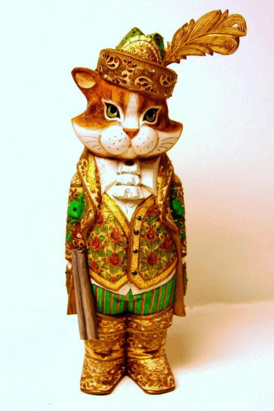 Эта деревянная статуэтка-кошка уникально вырезана из ...