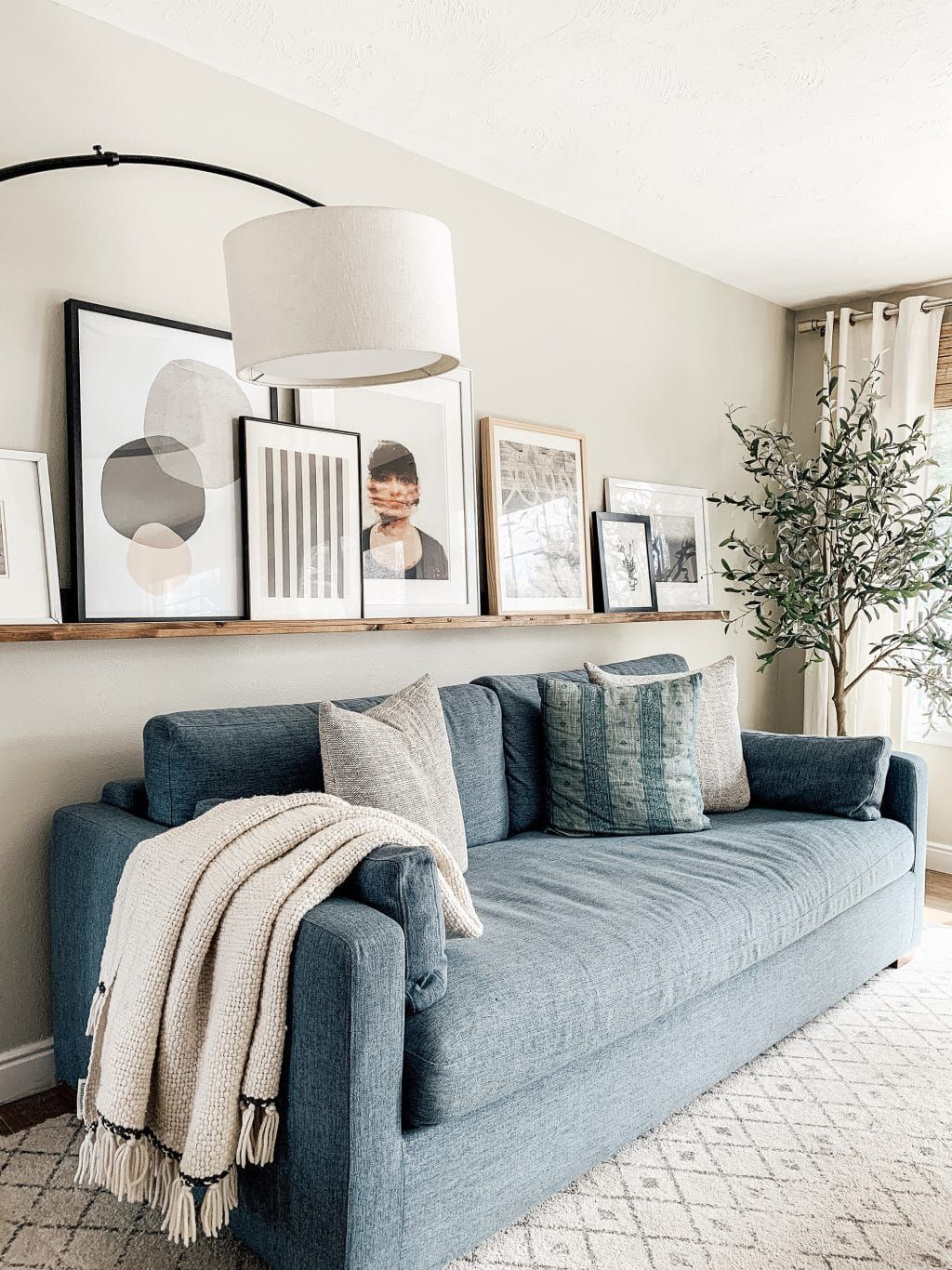 Mix It Up 10 Ways To Display Art In Your Home Living Room Pictures Living Room Wall Home Decor