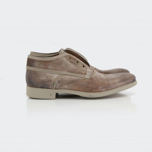 John Varvatos Dylan Binded Chukka.  These John Varvatos Collection men's chukkas, feature a worn leather body with distressed finished and rubber sole.  The laceless detailing gives a distinct edge.  An effortless shoe that adds style to any look.