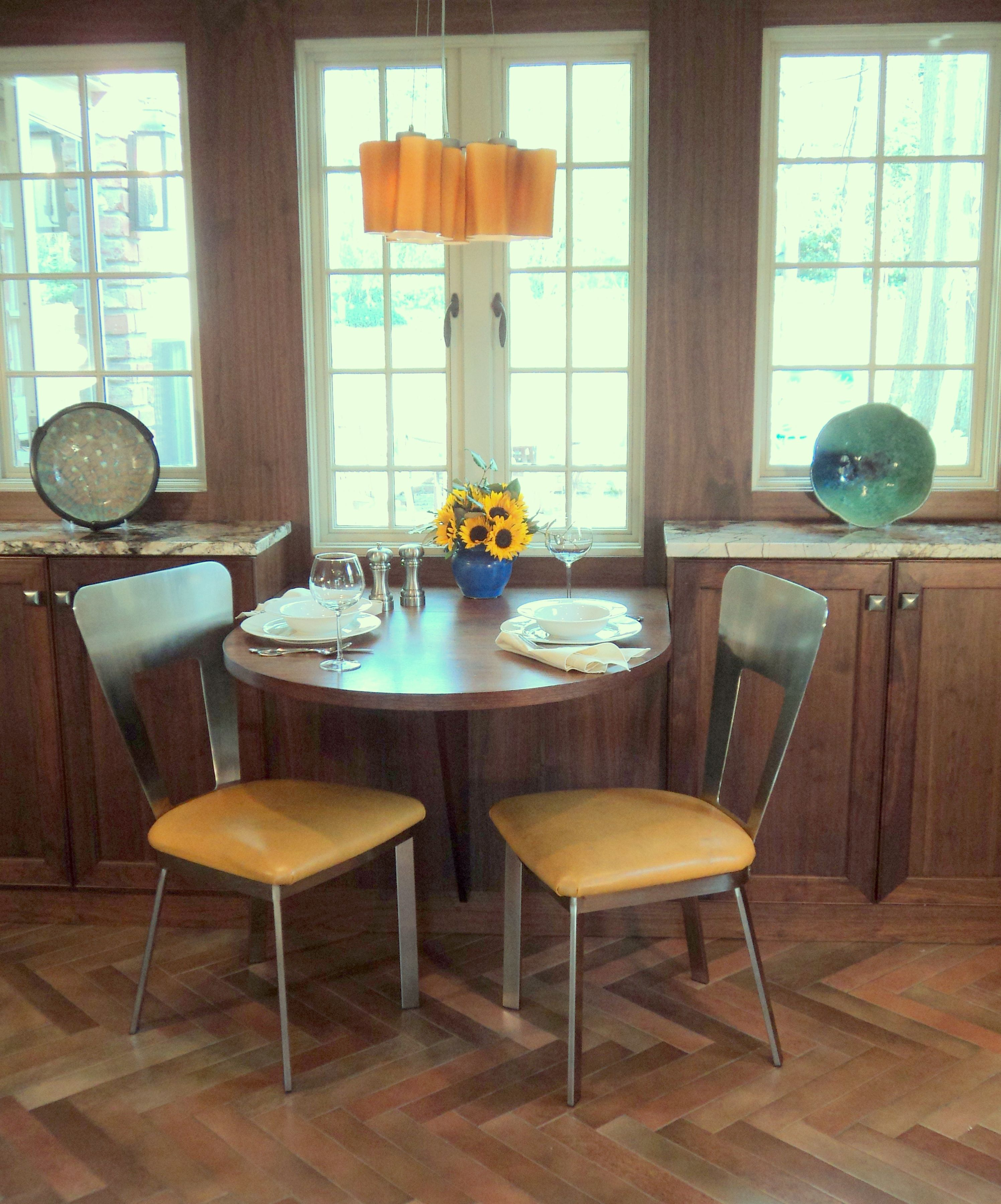 Stainless chairs with golden leather seats table top drops down to