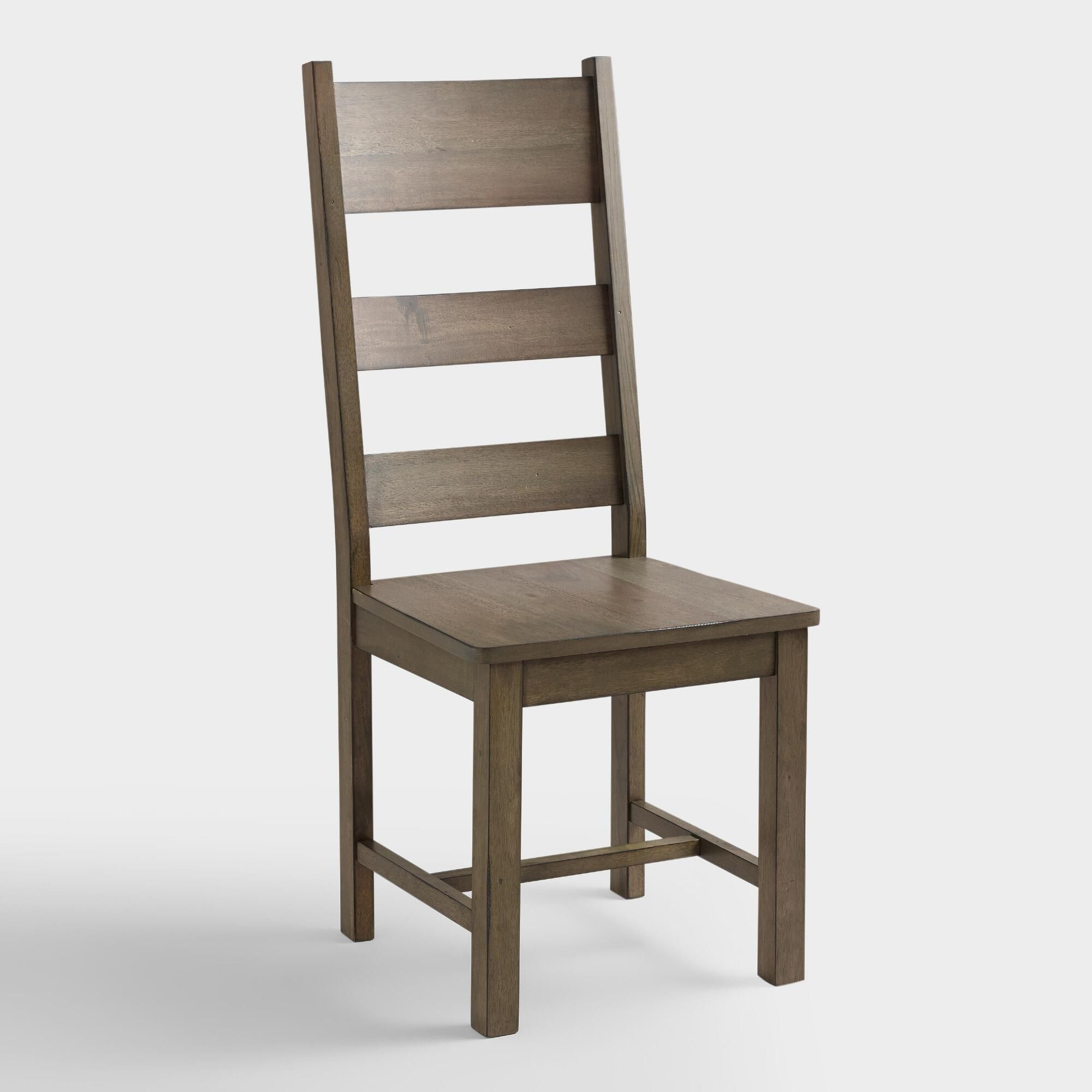 Crafted of rubberwood with a distressed finish that gives it a weathered aesthetic our classic dining chairs add farmhouse elegance to the table