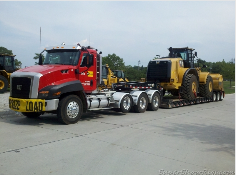 caterpillar custom ct660 heavy haul with a cat 980 loader on wagon
