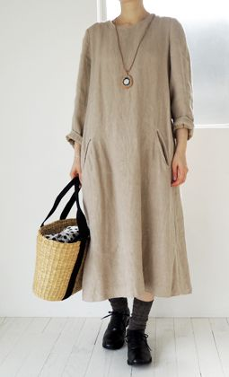 Linen dress.  I'd like this with 3/4 sleeves, a lighter color and leather sandals with a highly colored long necklace & dangly earrings.