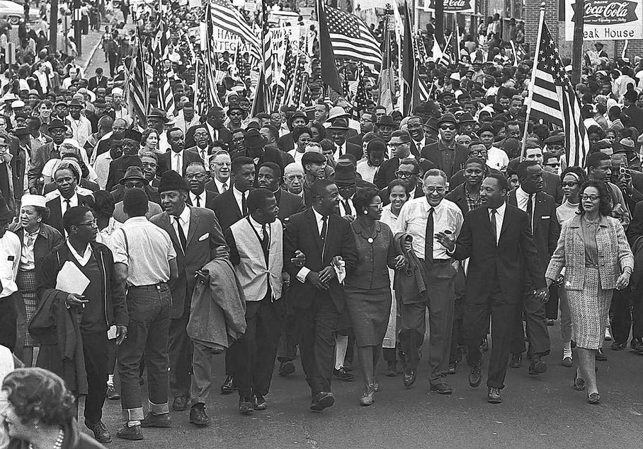 3rd attempt to cross the Edmund Pettus Bridge (marching from Selma to Montgomery) in the 1965 Voting Rights campaign in Selma, AL.  This third attempt drew over 8,000 people.  Martin Luther King and Coretta Scott King are on the right hand side.
