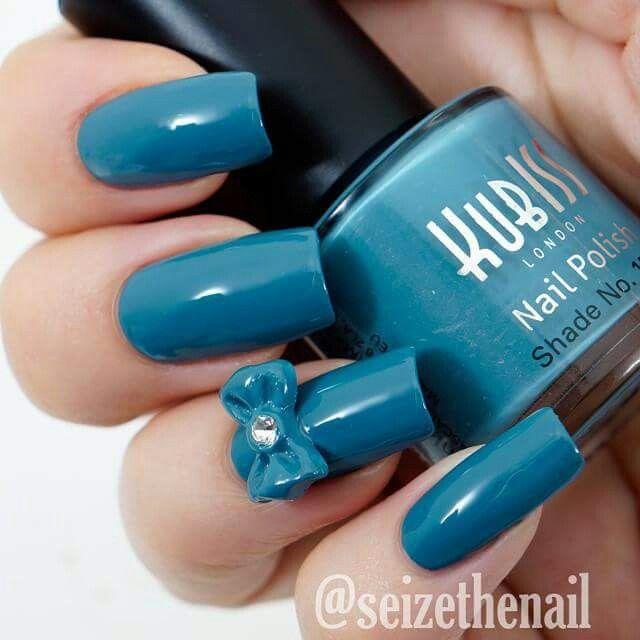 Beautiful blue- Wish I had nails like her