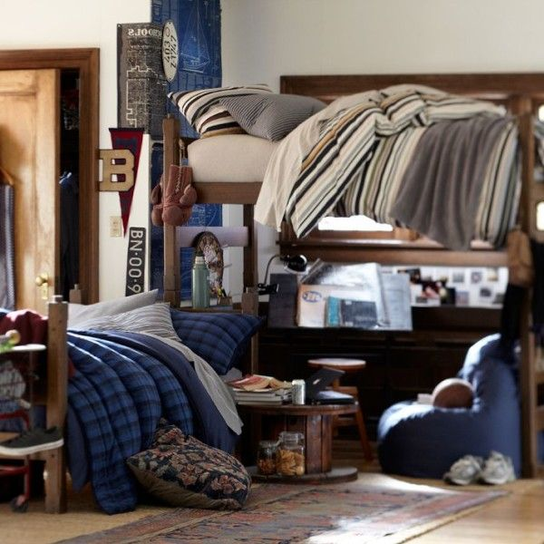 Another great idea for guys dorm room design. This dorm room design is for guys who have bunk beds. If you have the option to recover the bed from the bottom of the bunk bed then you should just remove it. The extra space beneath the bed can be used for studying or lounging purposes. #dormroomideasforguys
