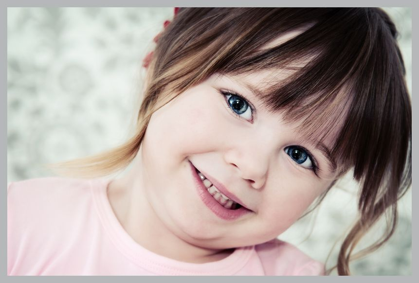 Little Girl With Fair Skin Brown Hair And Beautiful Blue Eyes
