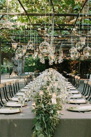 Outdoor wedding with handing tea light candles brides of adelaide wedding decor garlands along table hanging votives and lights junglespirit Image collections