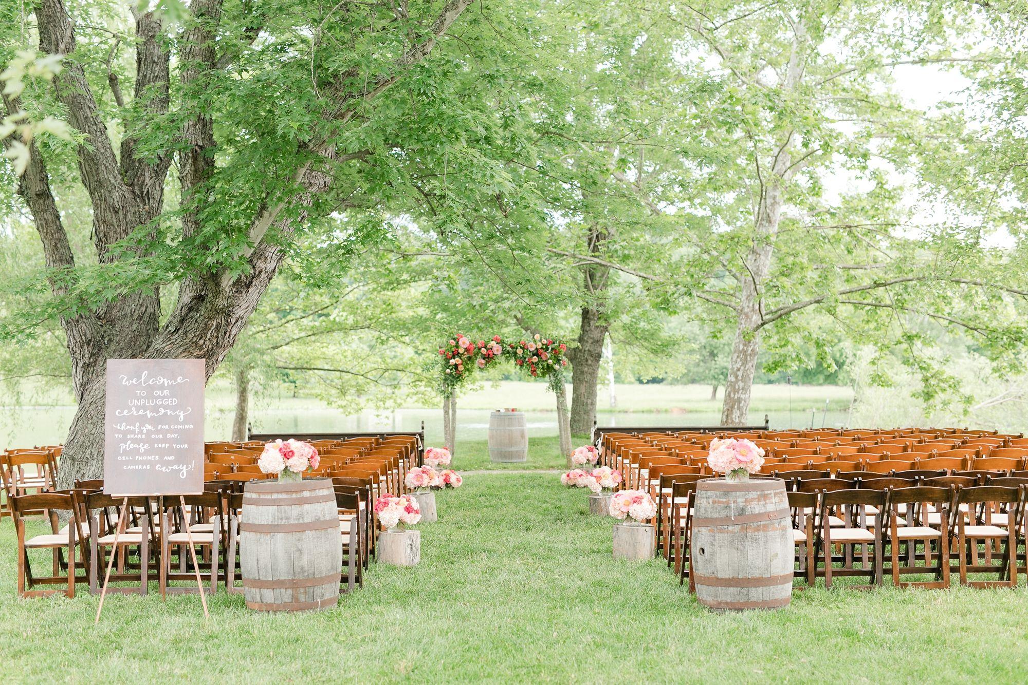 wedding ceremony setup florals outdoor wedding Wedding