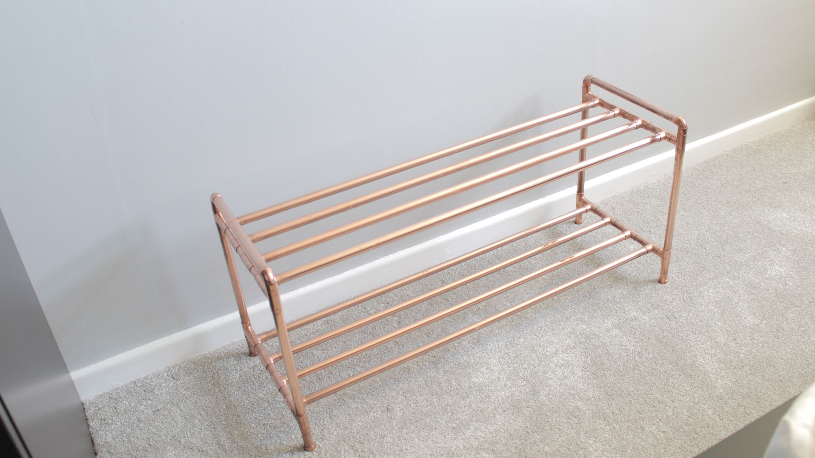 Industrial copper pipe shoe rack Add a modern touch to any home
