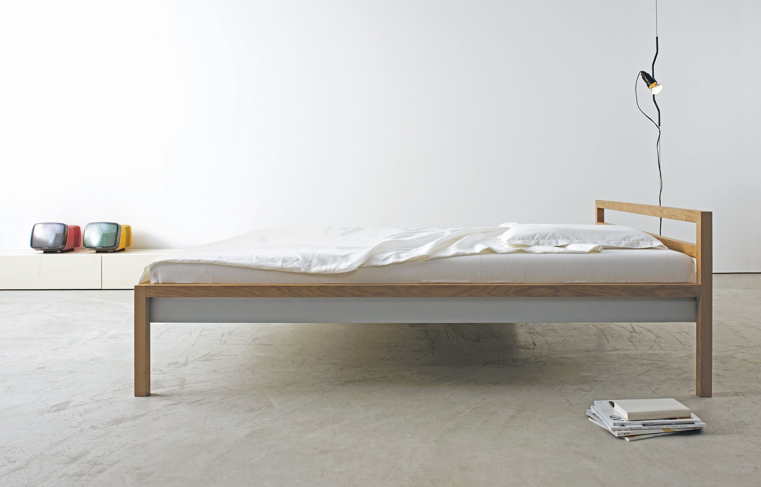 Massivholzbetten design  Bedroom furniture by more. ROOM bed presented in white pigmented ...