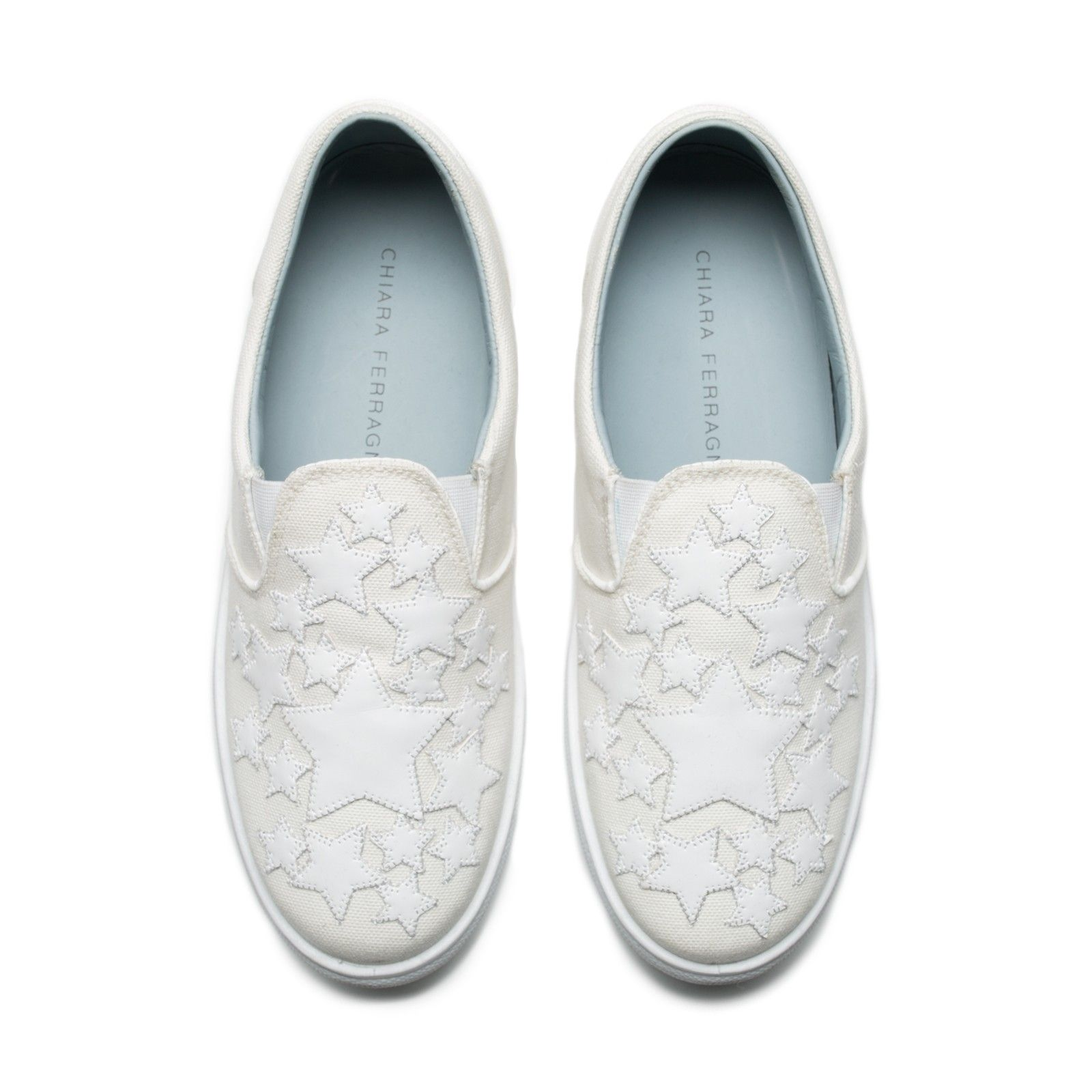 "cc3834321016 White canvas slip-ons with white ""stars"" patent patches. Light blue leather  lining and insole. Made in Italy"