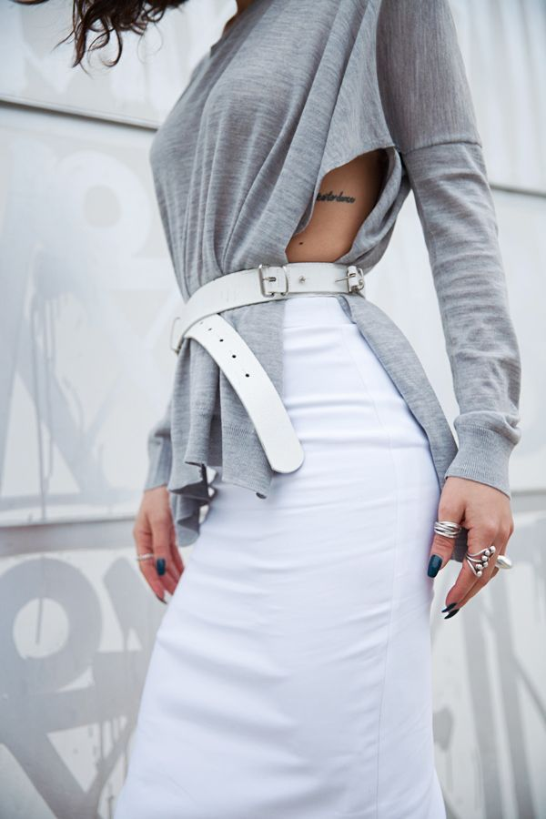 Grey loose shirt with high waist skirt and belt.