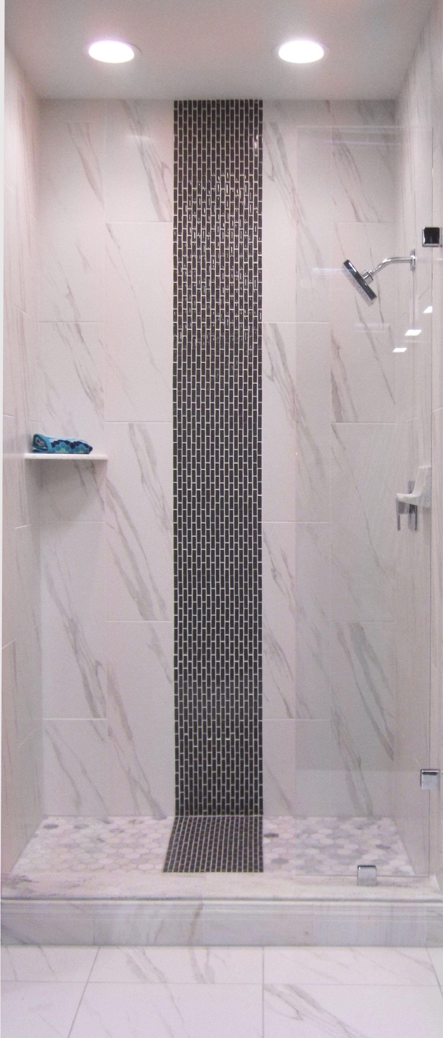 A glass strip mosaic in the shower thetileshop house