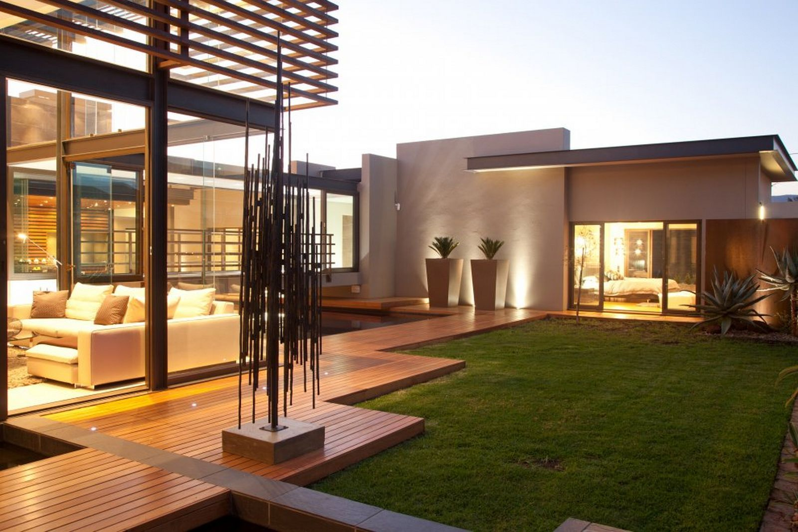 Living At Home Abo sculpture adds interest to the modern outdoor living space stylish