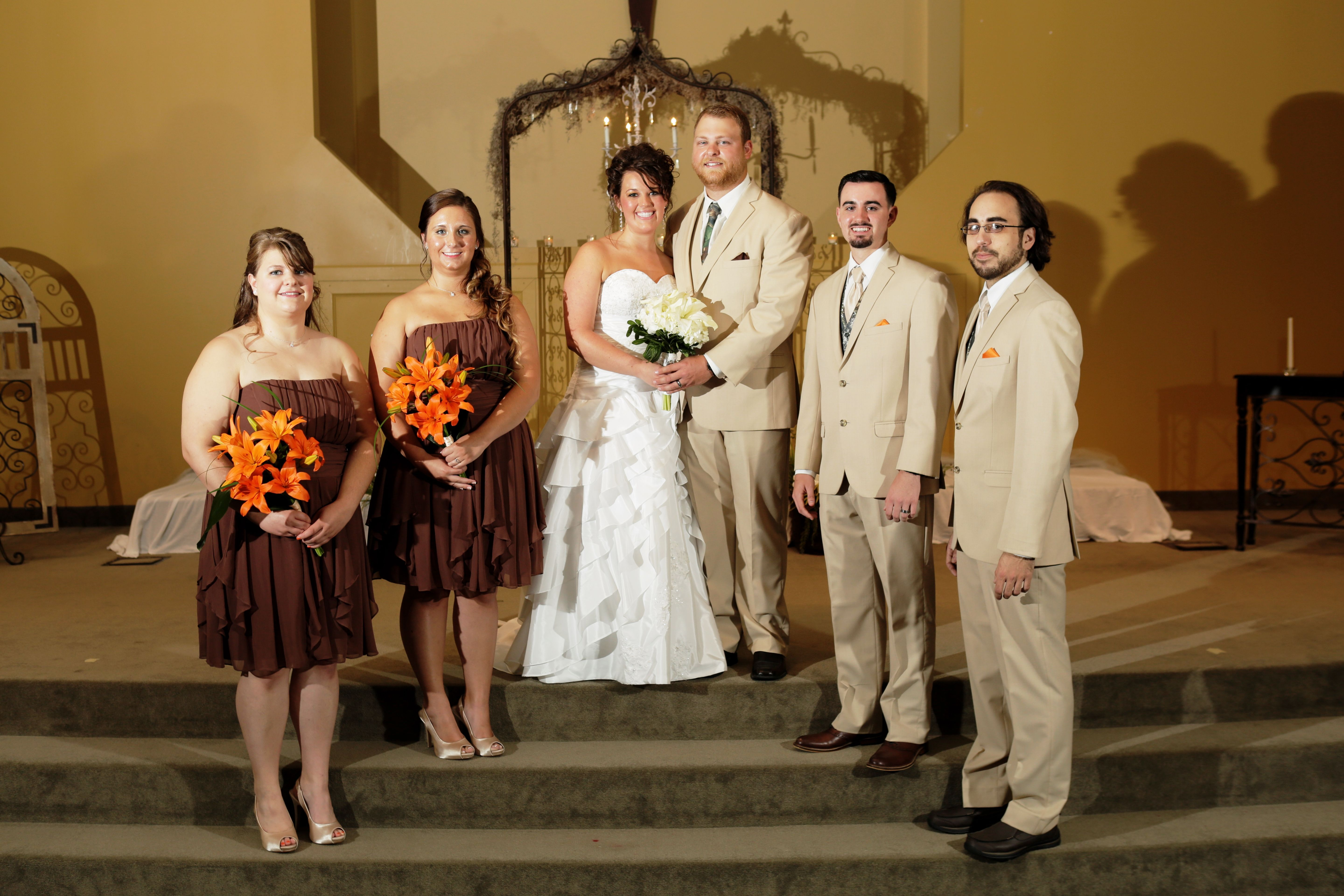 Small wedding party for a summer wedding knee length brown knee length brown bridesmaid dresses with orange bouquets the groomsmen were in tan suits tan tie camo vests orange pocket squares ombrellifo Gallery