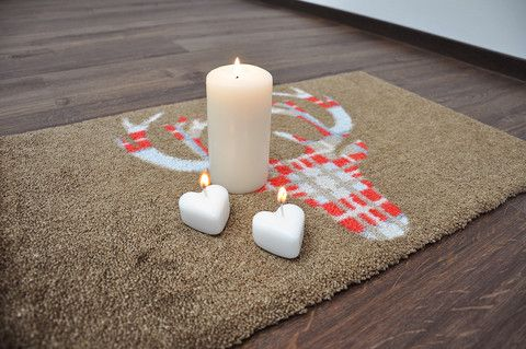 Kerzenwachs aus dem Teppich entfernen
