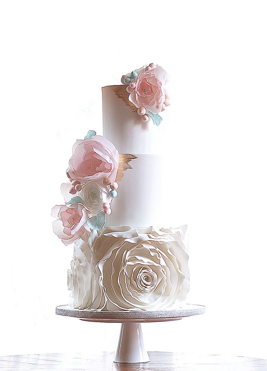 Tiered wedding cake with watercolor pink sugar florals and flower ...