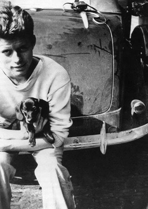 President Kennedy with his dachshund.