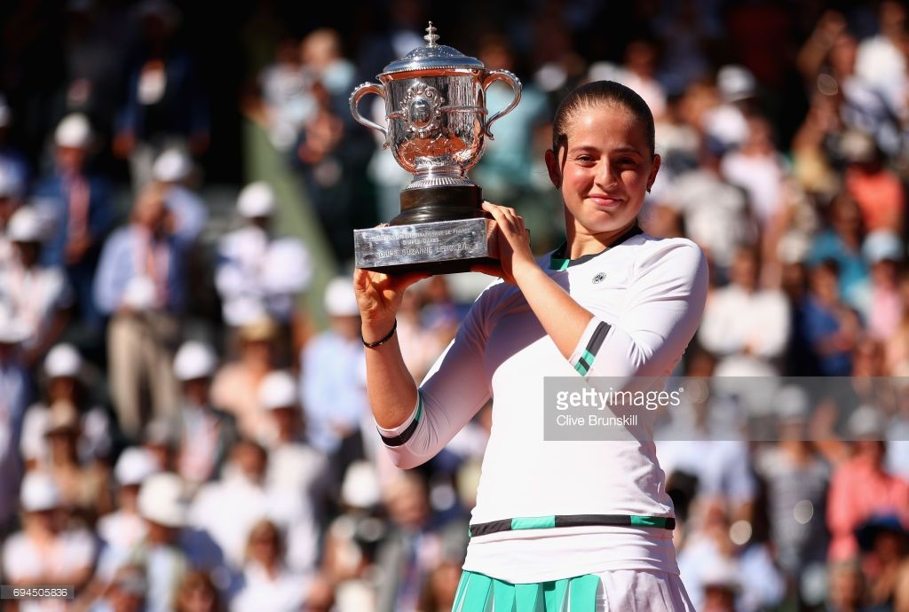 Jelena Ostapenko of Latvia celebrates victory with the trophy following the ladies singles final match against Simona Halep of Romania on day fourteen of the 2017 French Open at Roland Garros on June 10, 2017 in Paris, France.