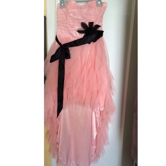 High Low , Strapless Dress Super cute high low, strapless pink dress! It has super cute black flower to its side with a black silky belt which can be taken off if desired. Only worn once but has no tag. It has this beautiful waterfall almost fall to it! Zipper works perfectly :)! Teeze Me  Dresses Strapless