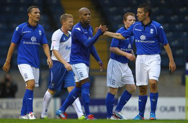 Marlon King is congratulated for his goal against Bury. July 2012. #BCFC