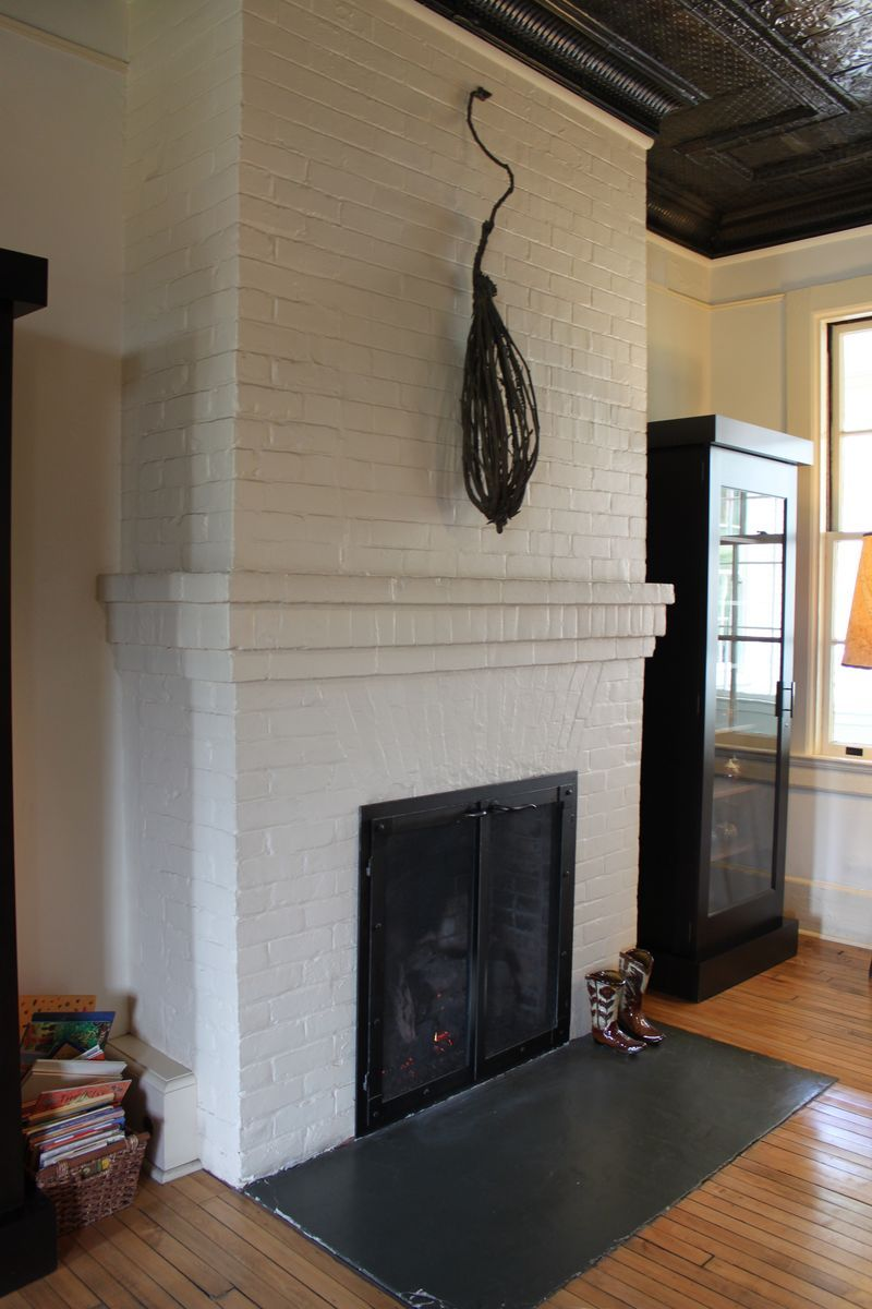 cavallo point white painted brick fireplace with either a slate