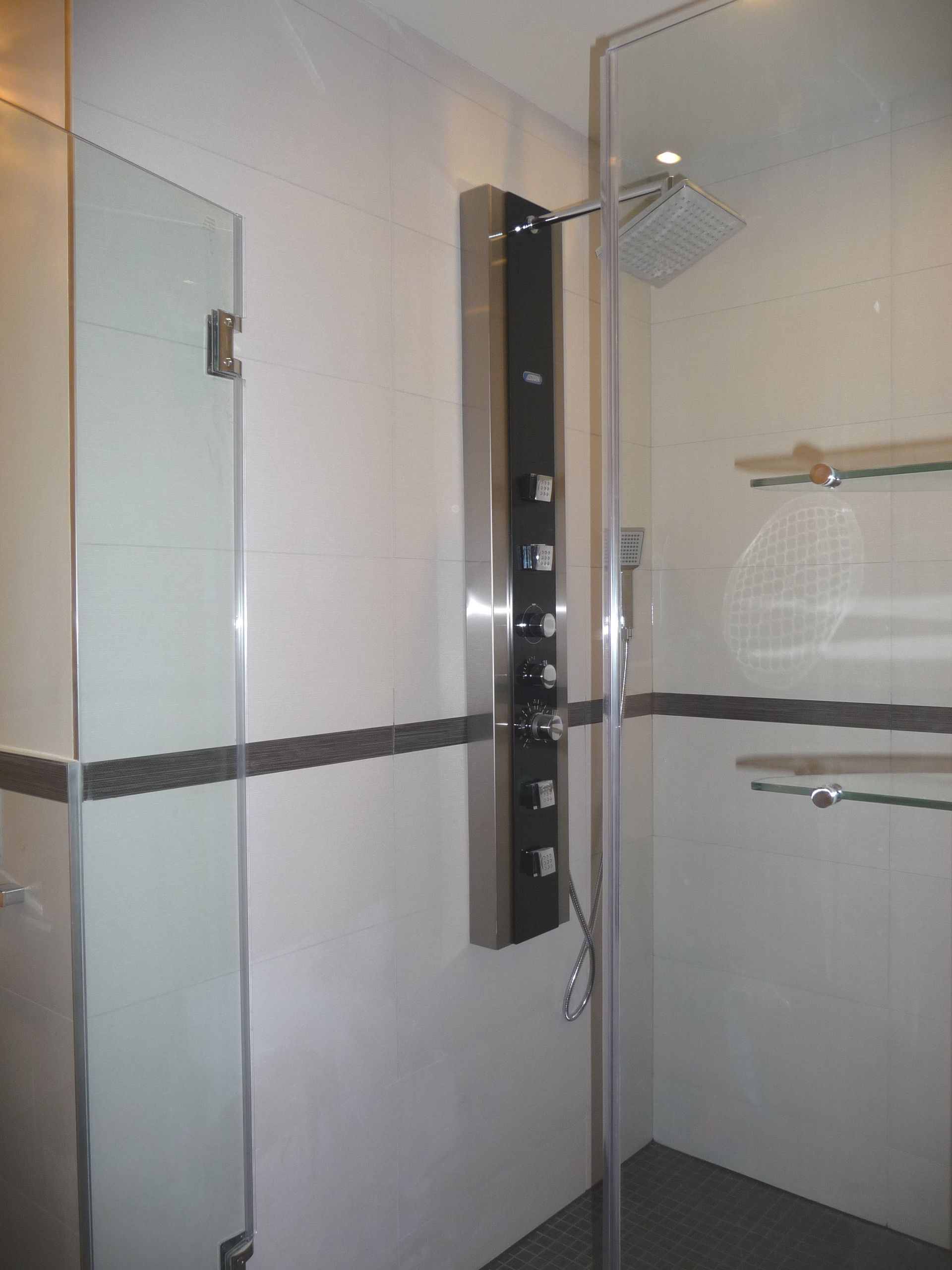 Shower room with rimless glass, jetted shower panel and glass ...