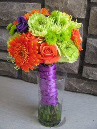 This bouquet is an exapmle of TRIADIC harmony with the colours Violet, Yellow Green and Orange ...